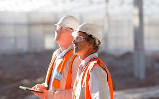 Auditors at a construction site