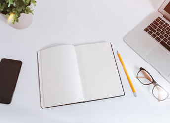 Notebook with other tabletop objects