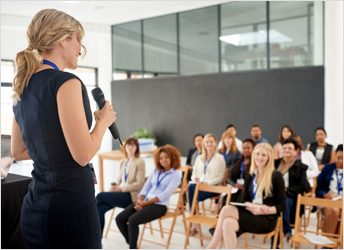 Businesswoman delivering a presentation at a conference